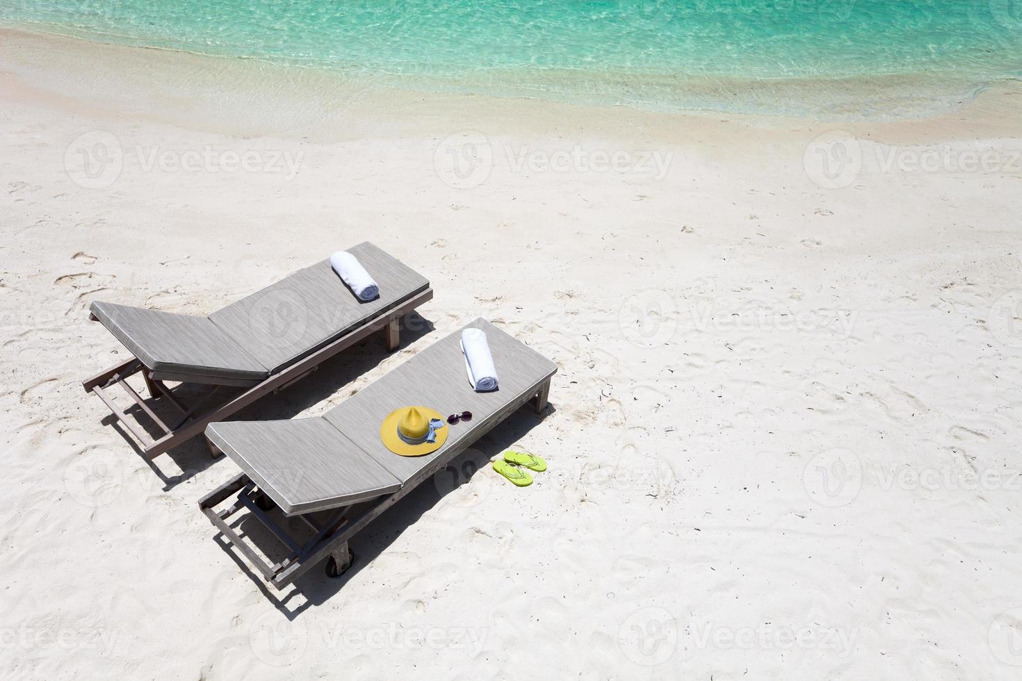 Lounge chairs on a beach photo