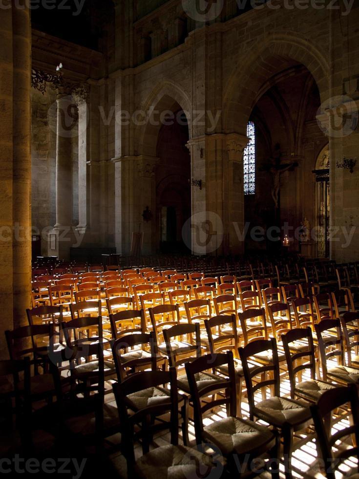 Sun shines inside an empty church in France photo