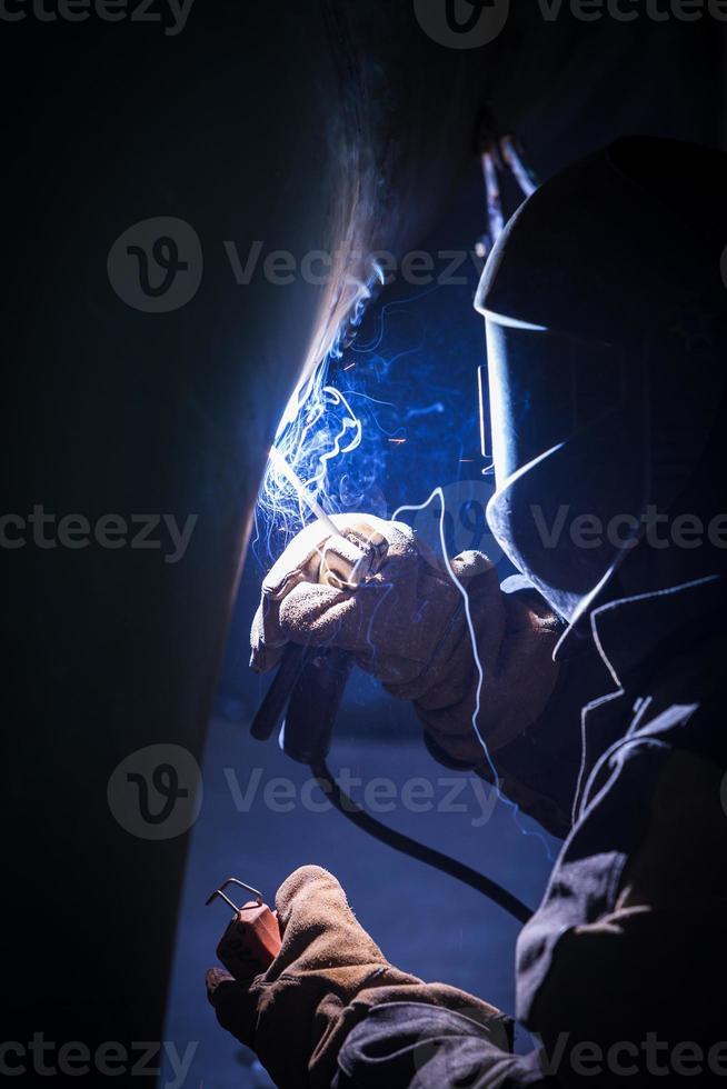 Arc welder at work photo