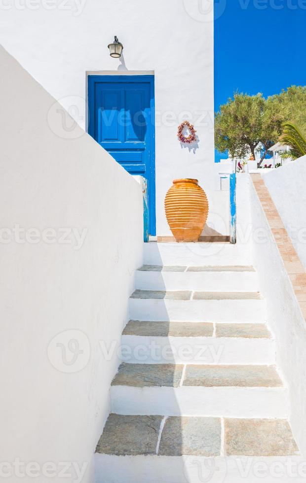 Staircase and ceramic vase near blue door, Sifnos, Greece photo