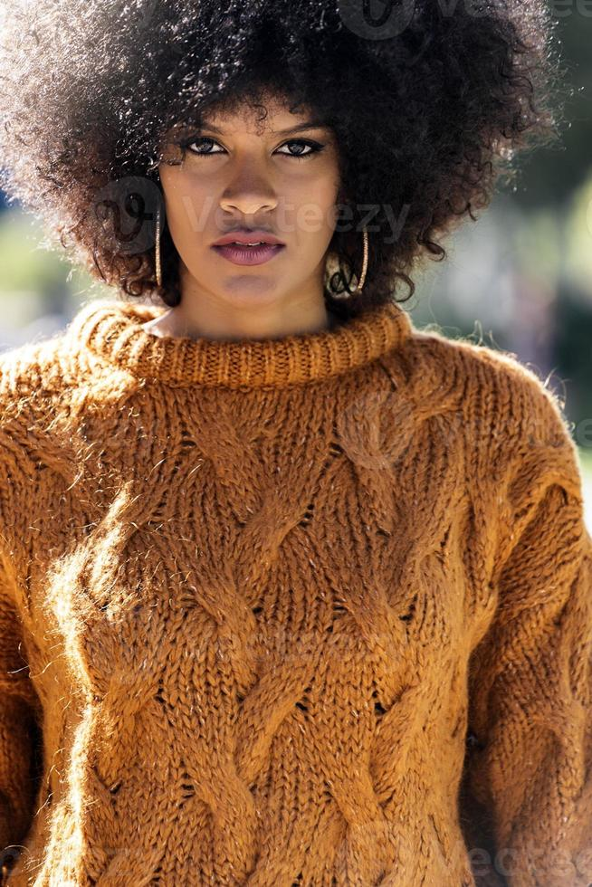 Portrait of attractive afro woman in the street photo