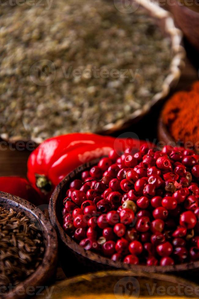 Oriental hot spices on wooden table photo