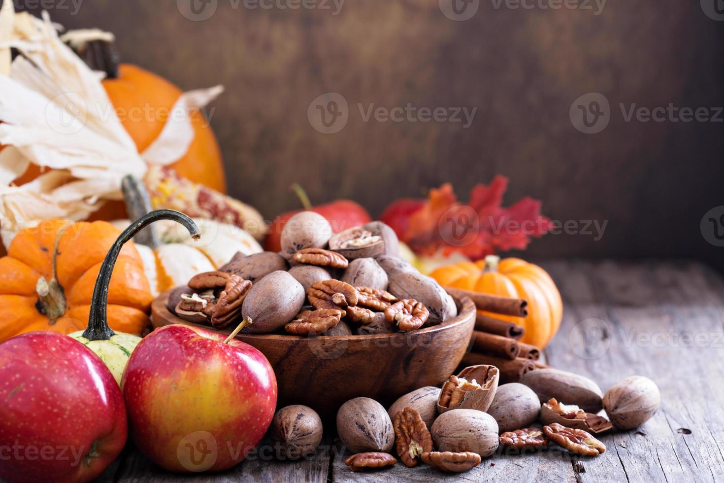 Pumpkins, nuts, indian corn and apples photo