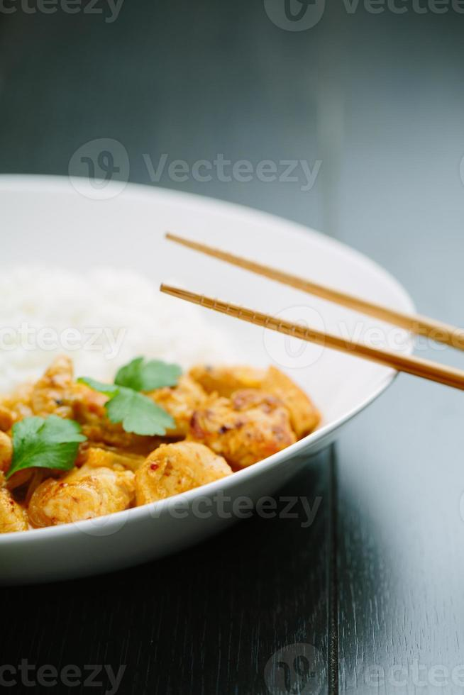 Spicy chicken curry with rice photo