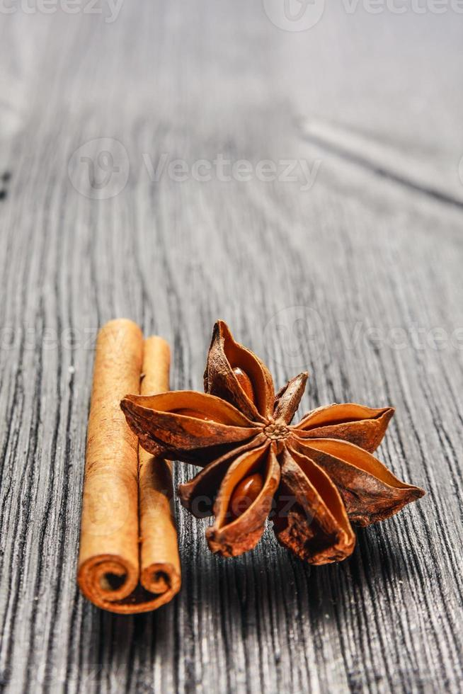 cinnamon and anise on the wooden background photo