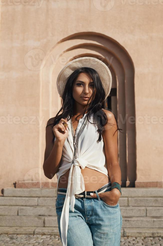 flirting indian lady in summer outfit against ancient building. photo