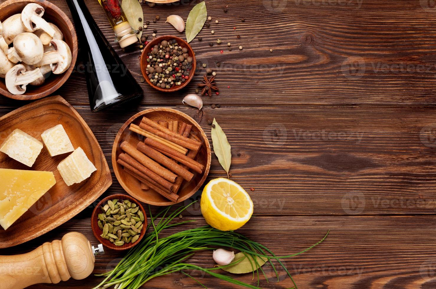Various spices on wooden background photo