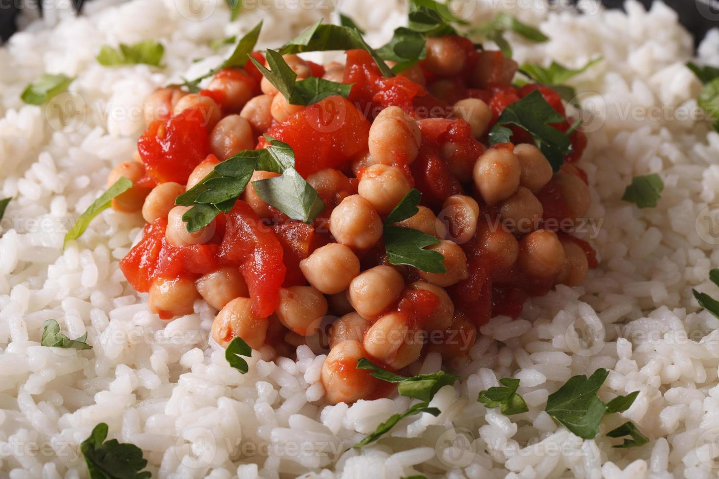 Rice with chickpea curry and herbs macro background photo