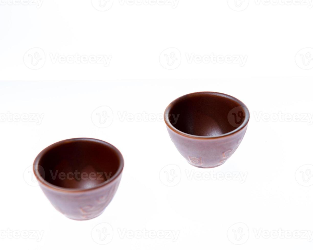 Two small sake or soju glasses on white background photo