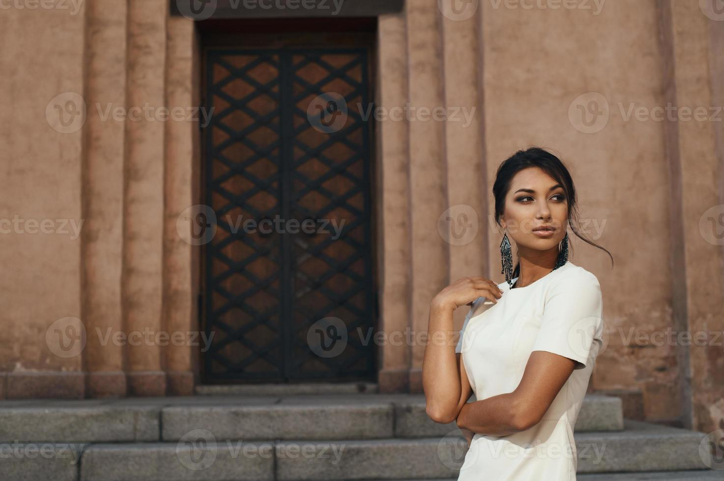 indian lady in dress against ancient building with thoughtful look photo