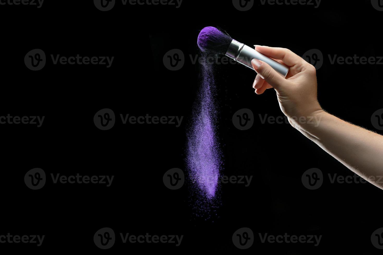 Makeup brush with holi paint photo