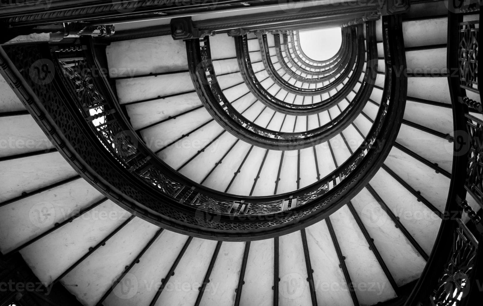Low angle view of spiral staircase photo