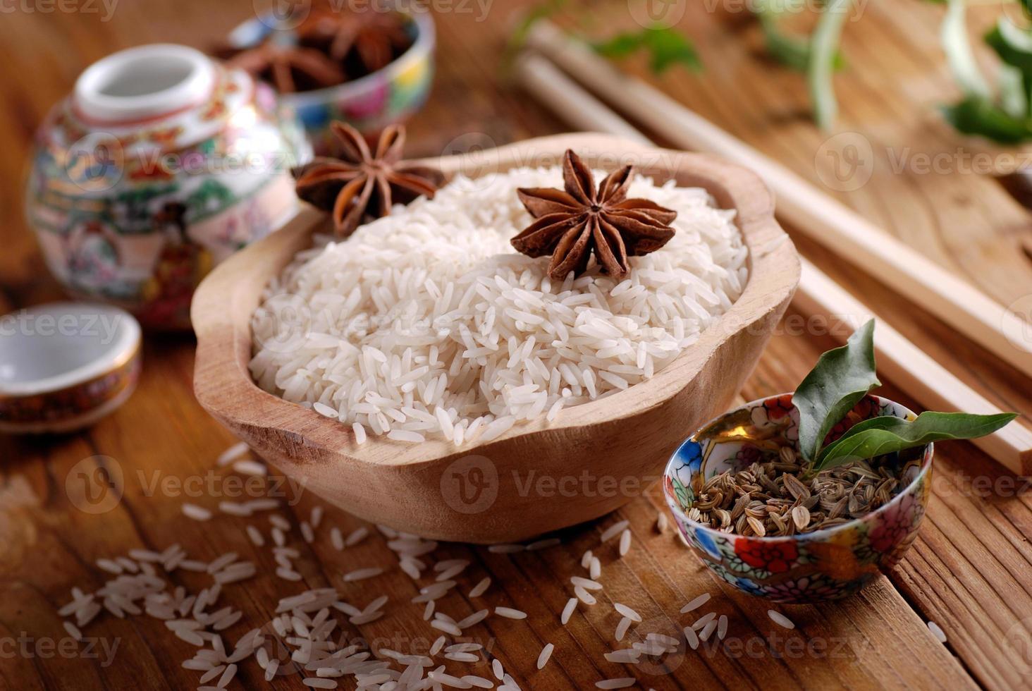 Basmati rice in wooden bowl photo