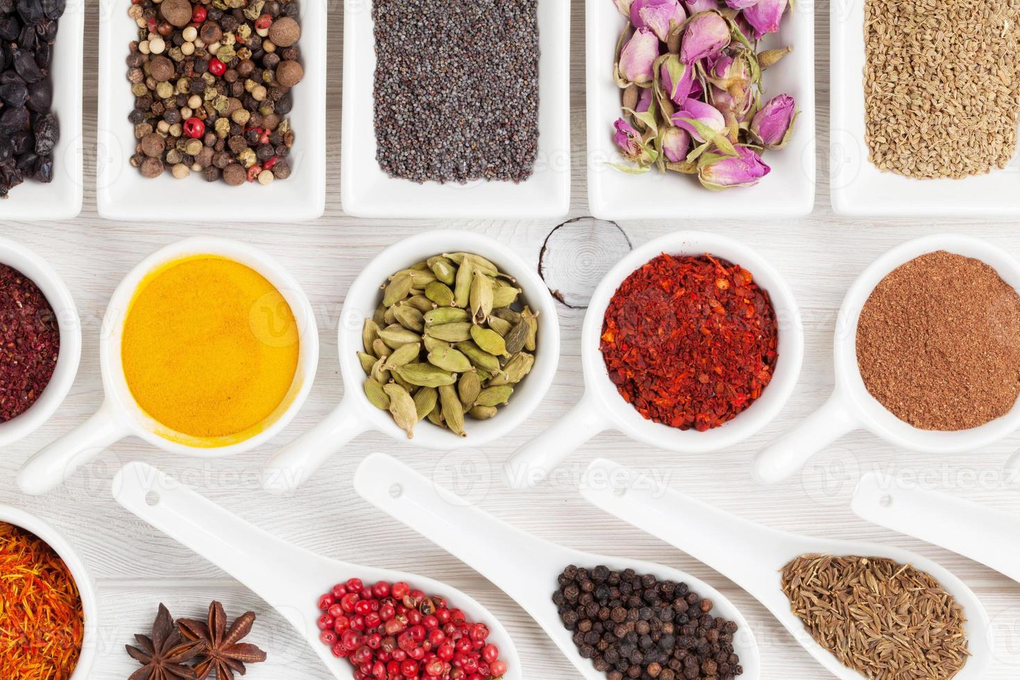 Various spices on white wooden background photo