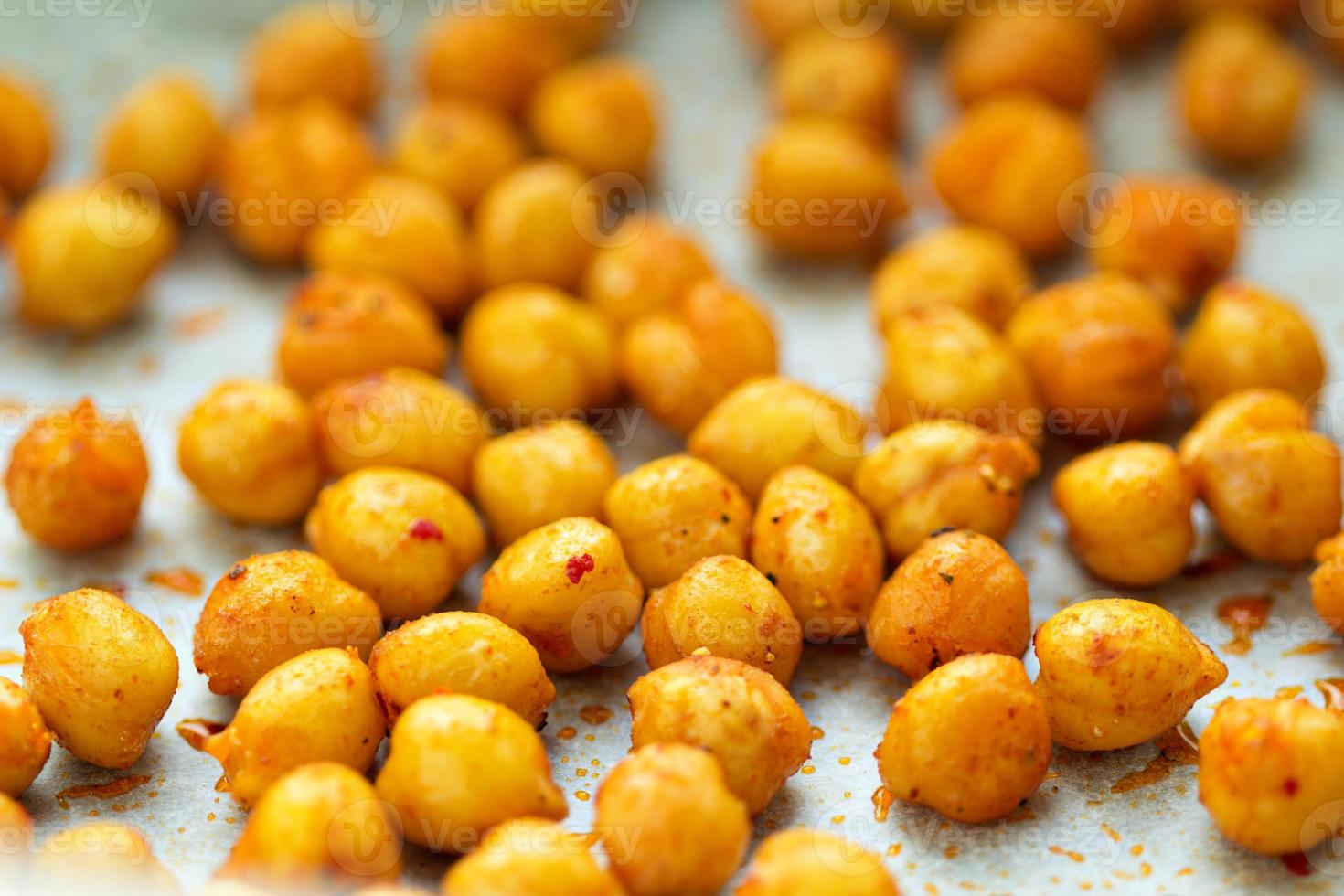 Roasted chickpeas on a baking tray photo