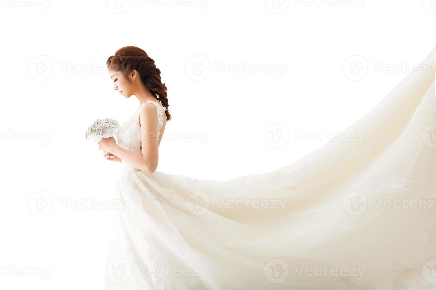 Young attractive bride with flowers photo