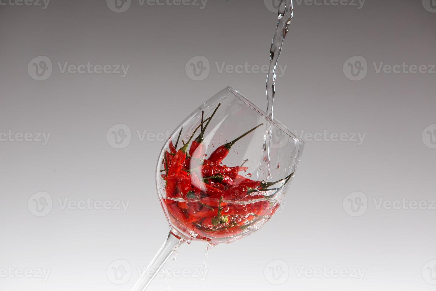 Red hot chili pepper in a glass photo