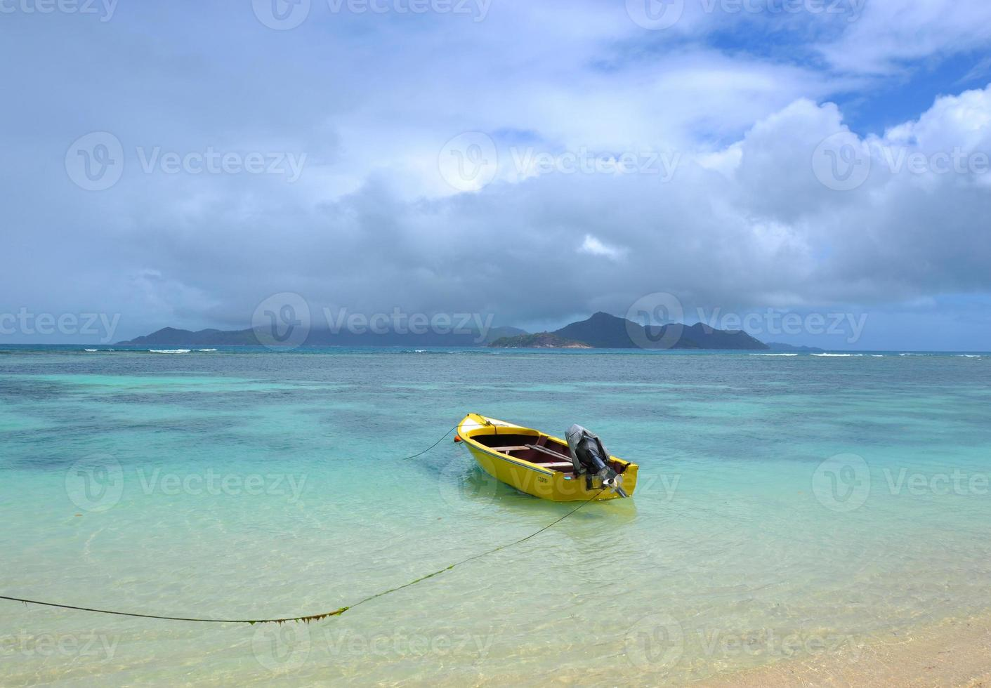 Boat  yellow on the Beach of La Digue photo
