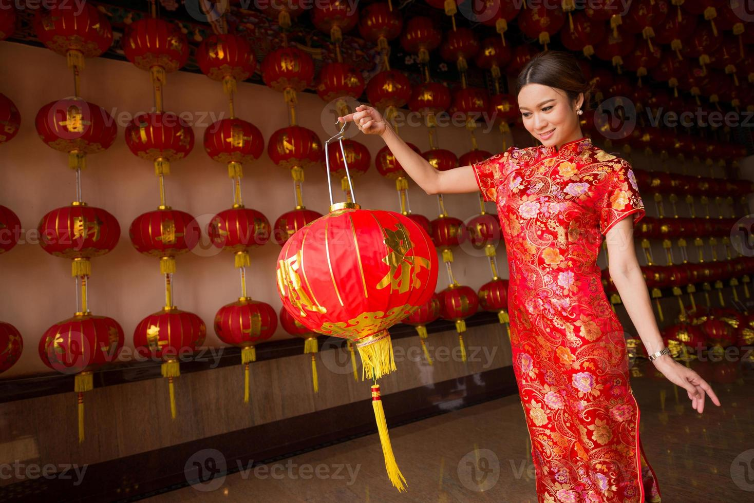girl in qipao holding lantern photo