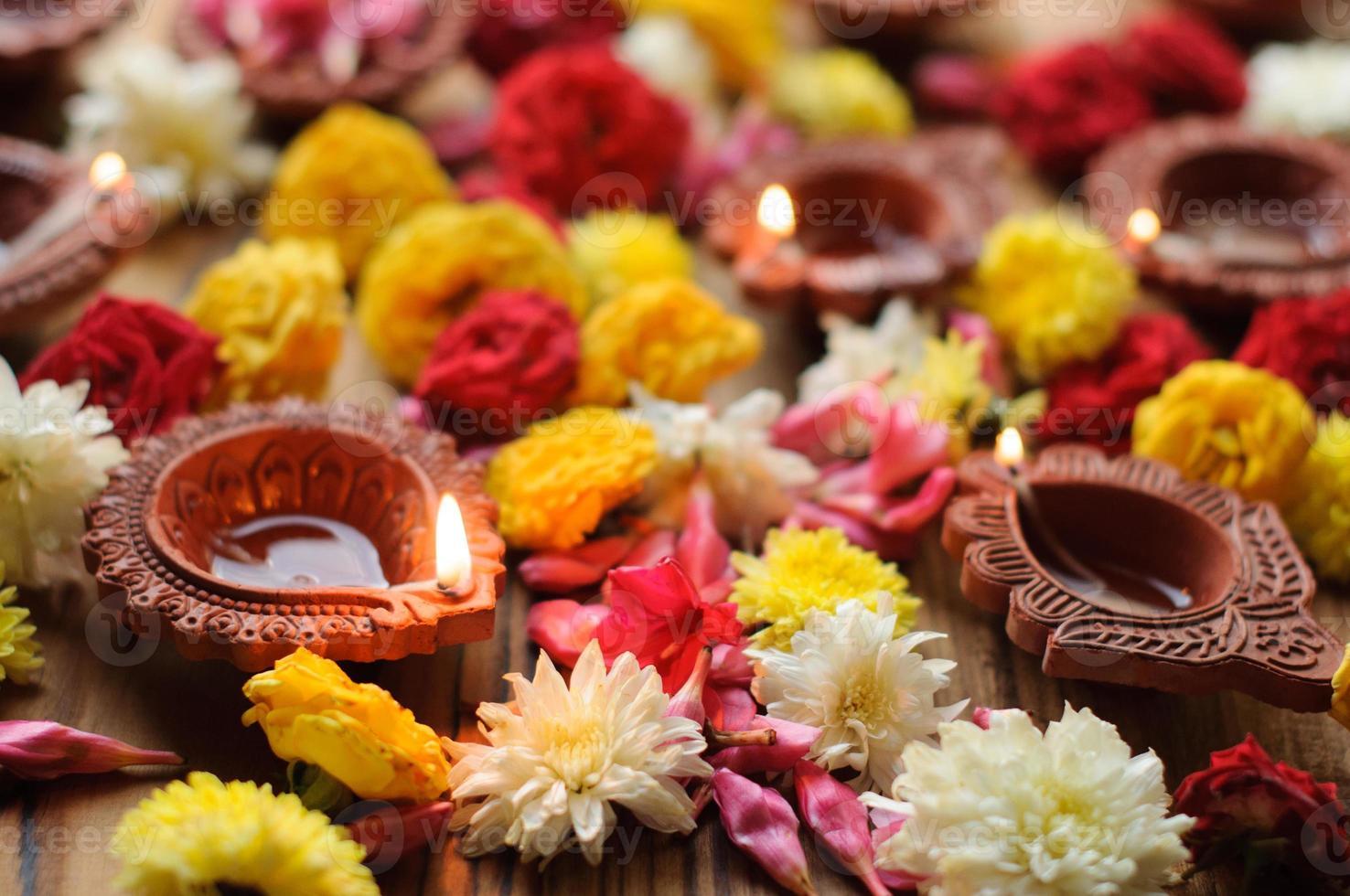Colorful clay diya lamps lit during diwali celebration photo