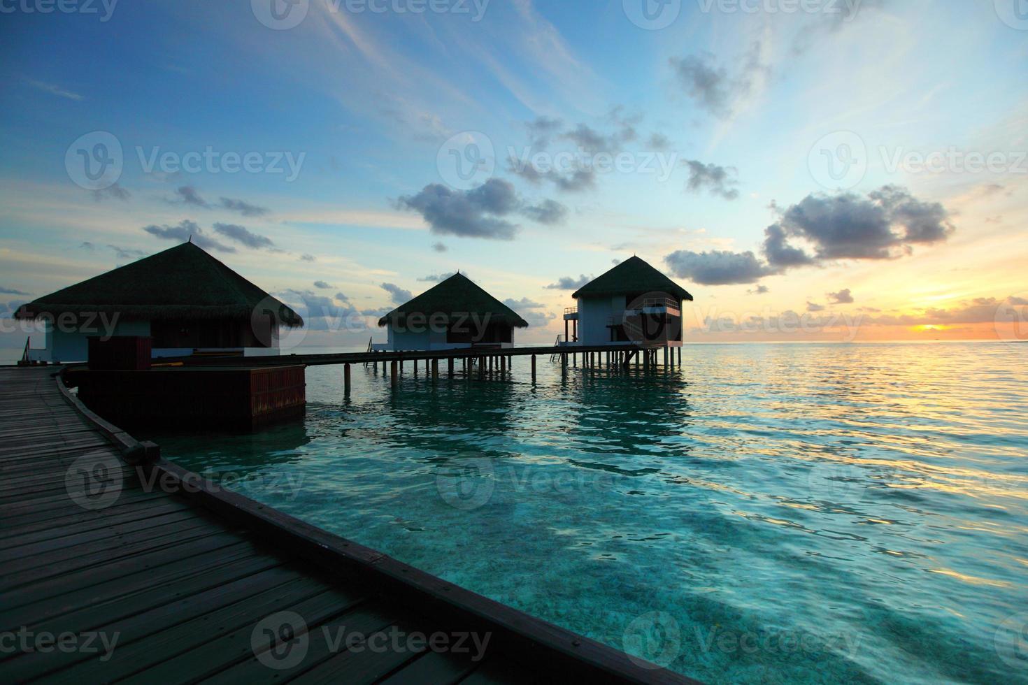 maldivian houses on sunrise photo