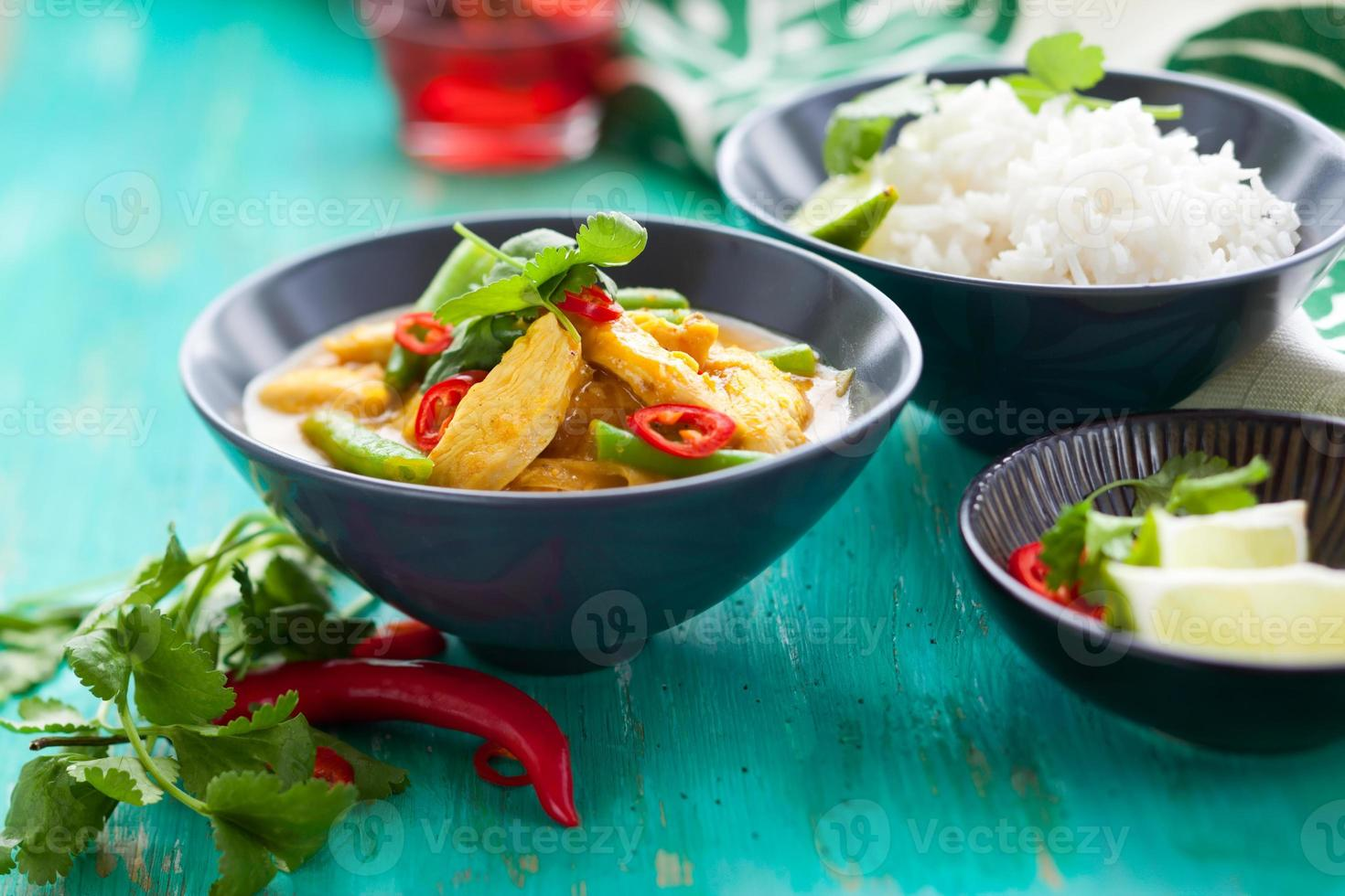 Chicken curry in bowl with rice photo