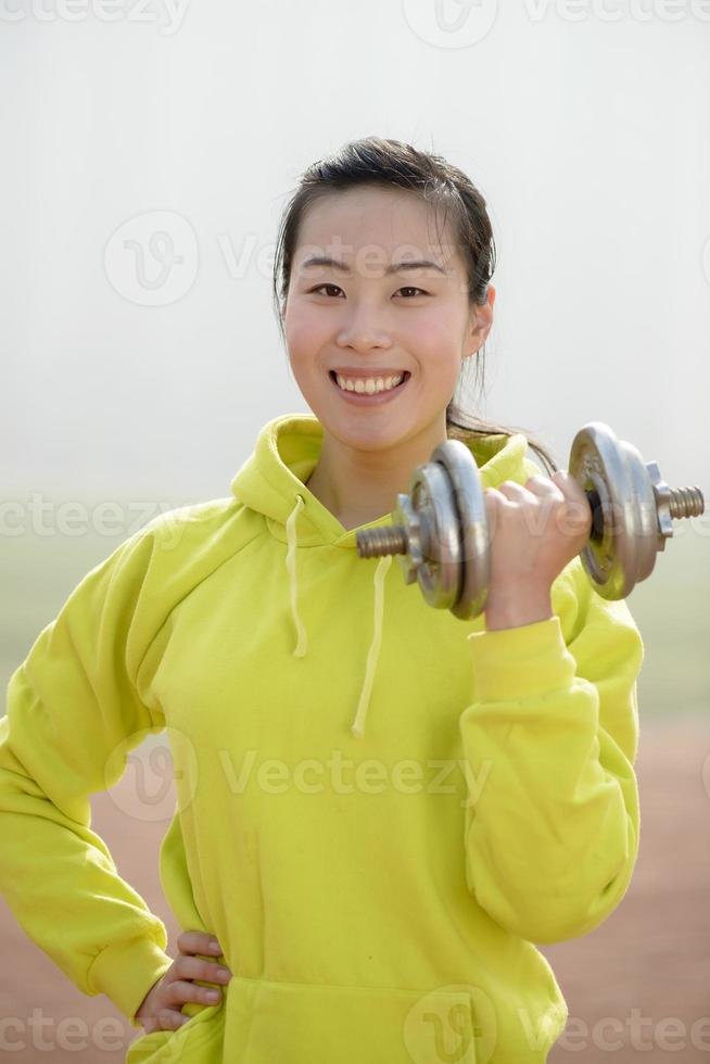 fitness woman working out with dumbbell photo