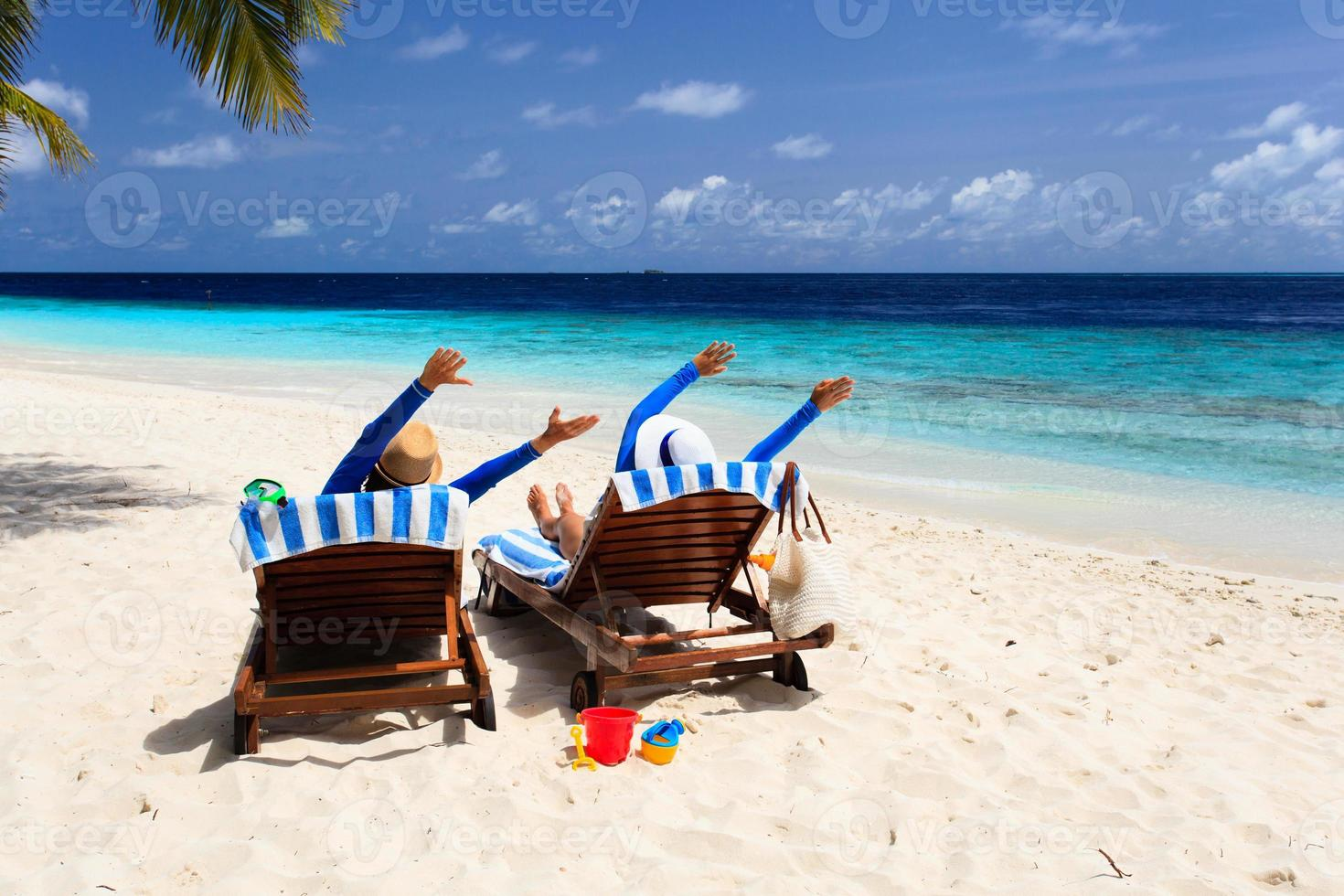 happy couple relax on a tropical beach photo