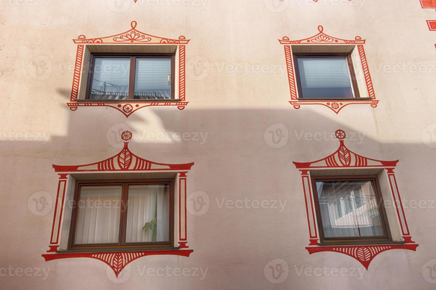 squared glass windows with brown frame and artistic border photo