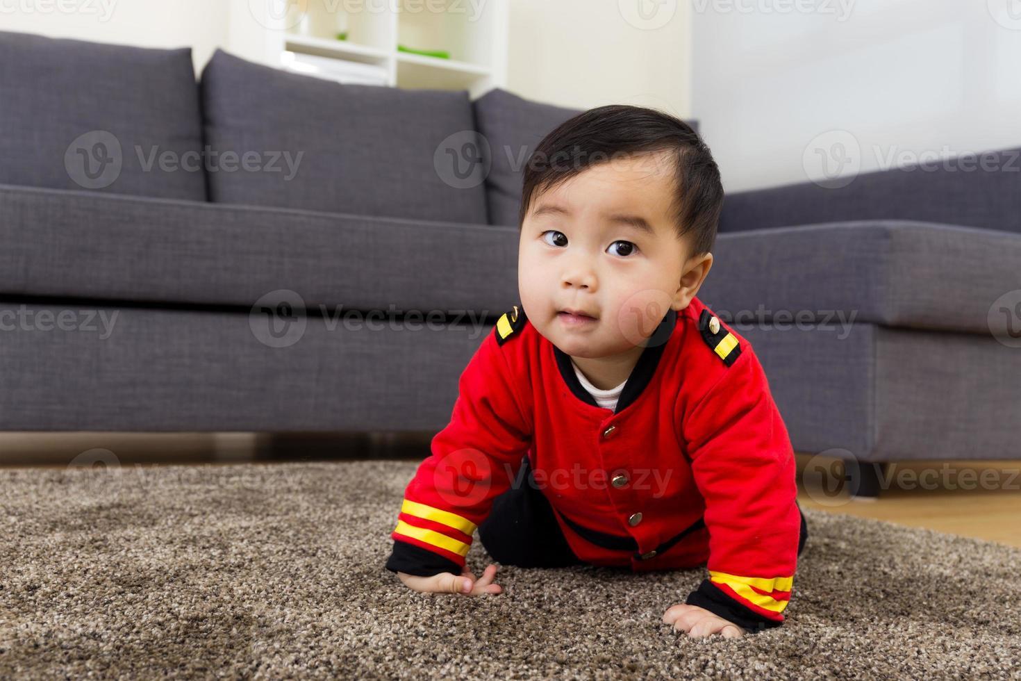 Baby crawling at home photo