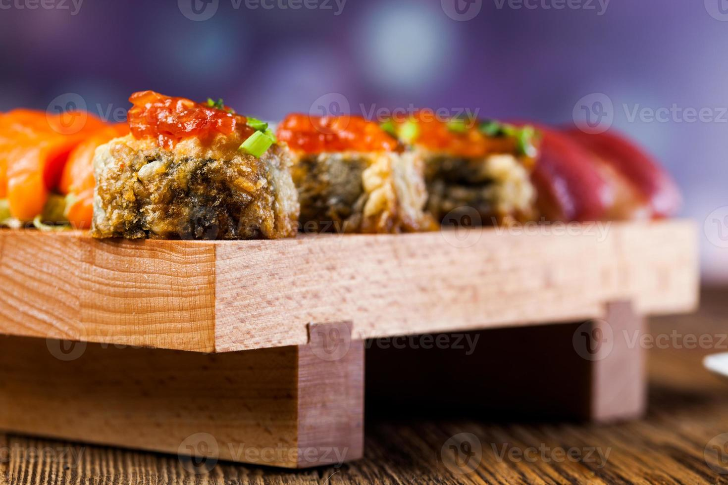 Japanese concept with sushi on the wooden table photo
