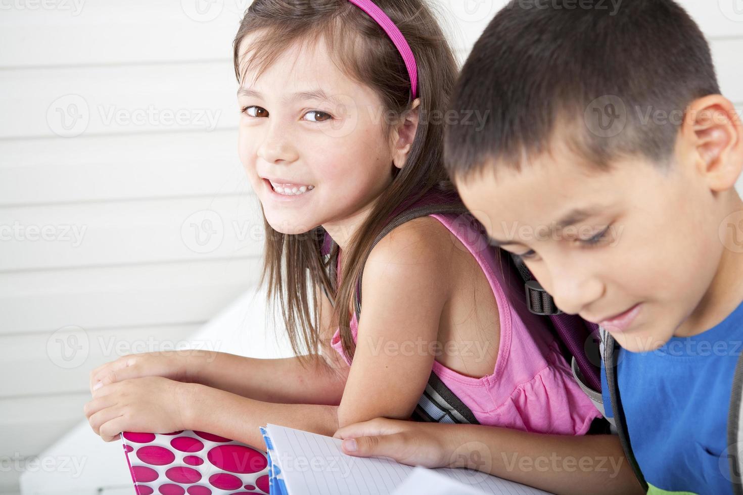 Siblings doing their homework photo