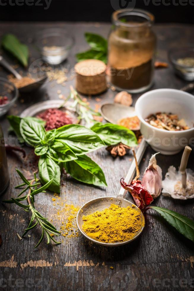 Oriental herbs and spices selection on rustic kitchen table photo