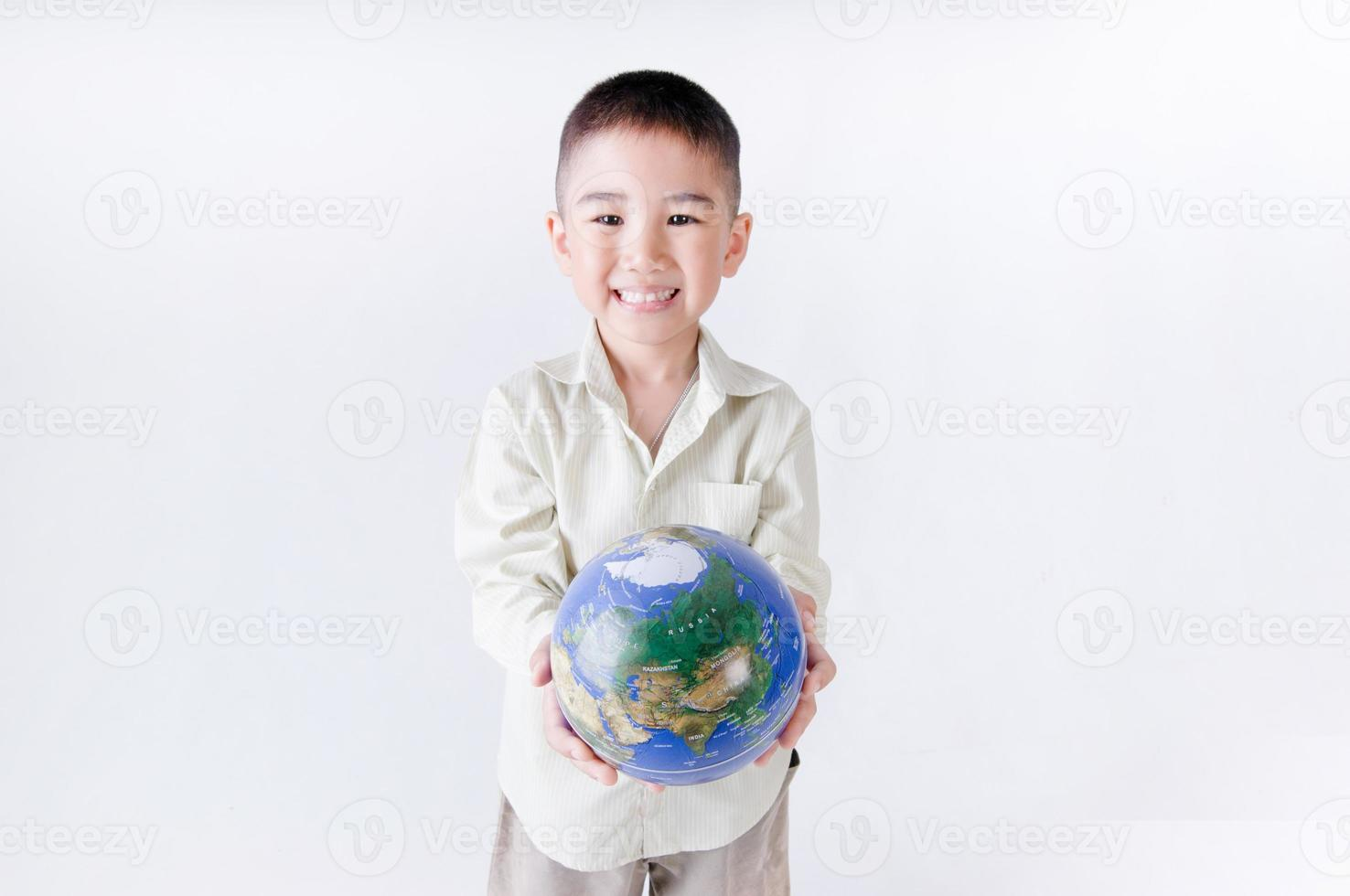Child holding the earth on a white background photo