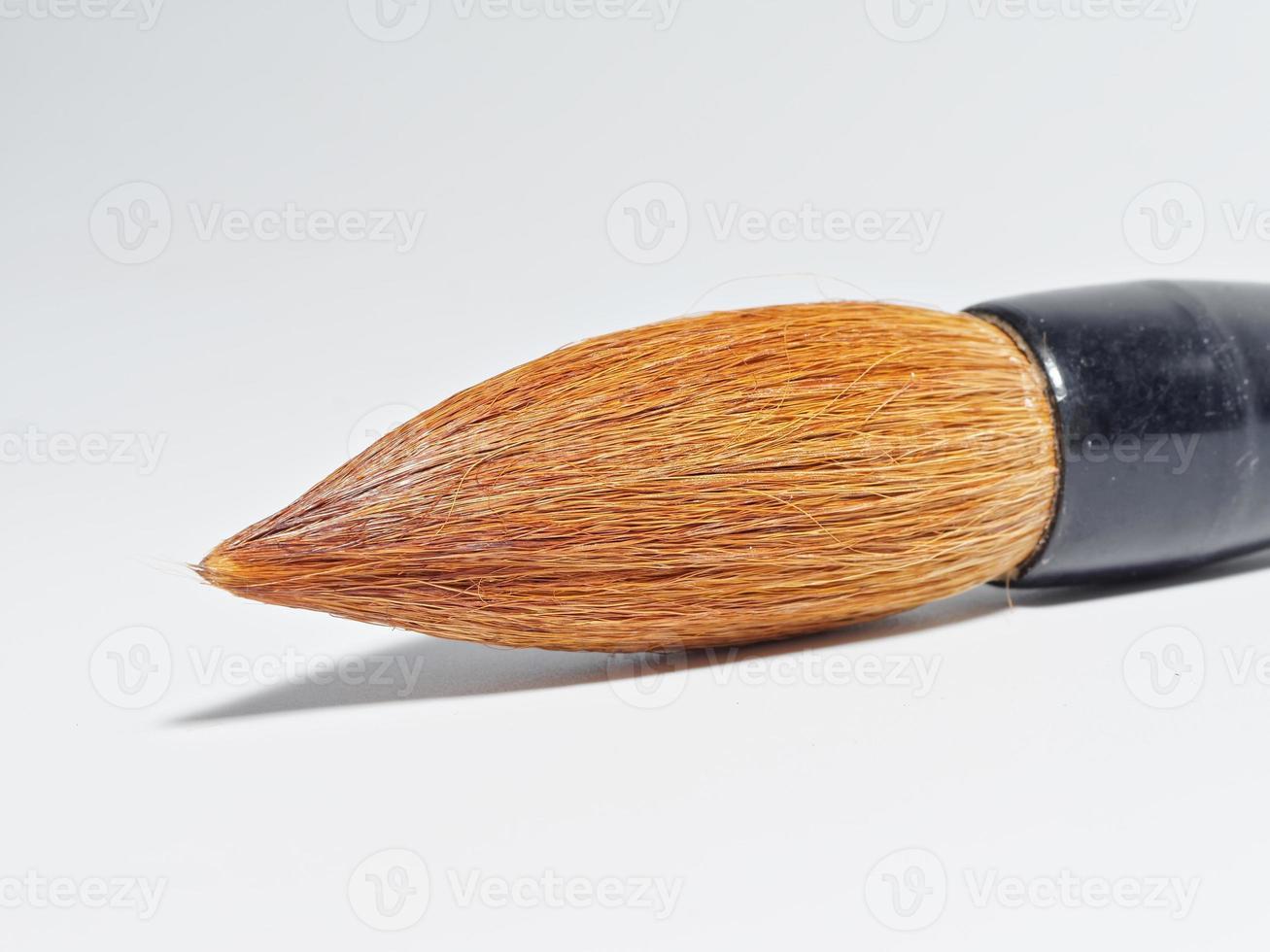 Chinese writing brush on white background photo