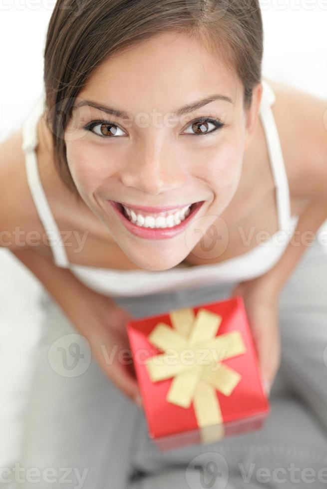 Woman receiving gift for valentine's day photo