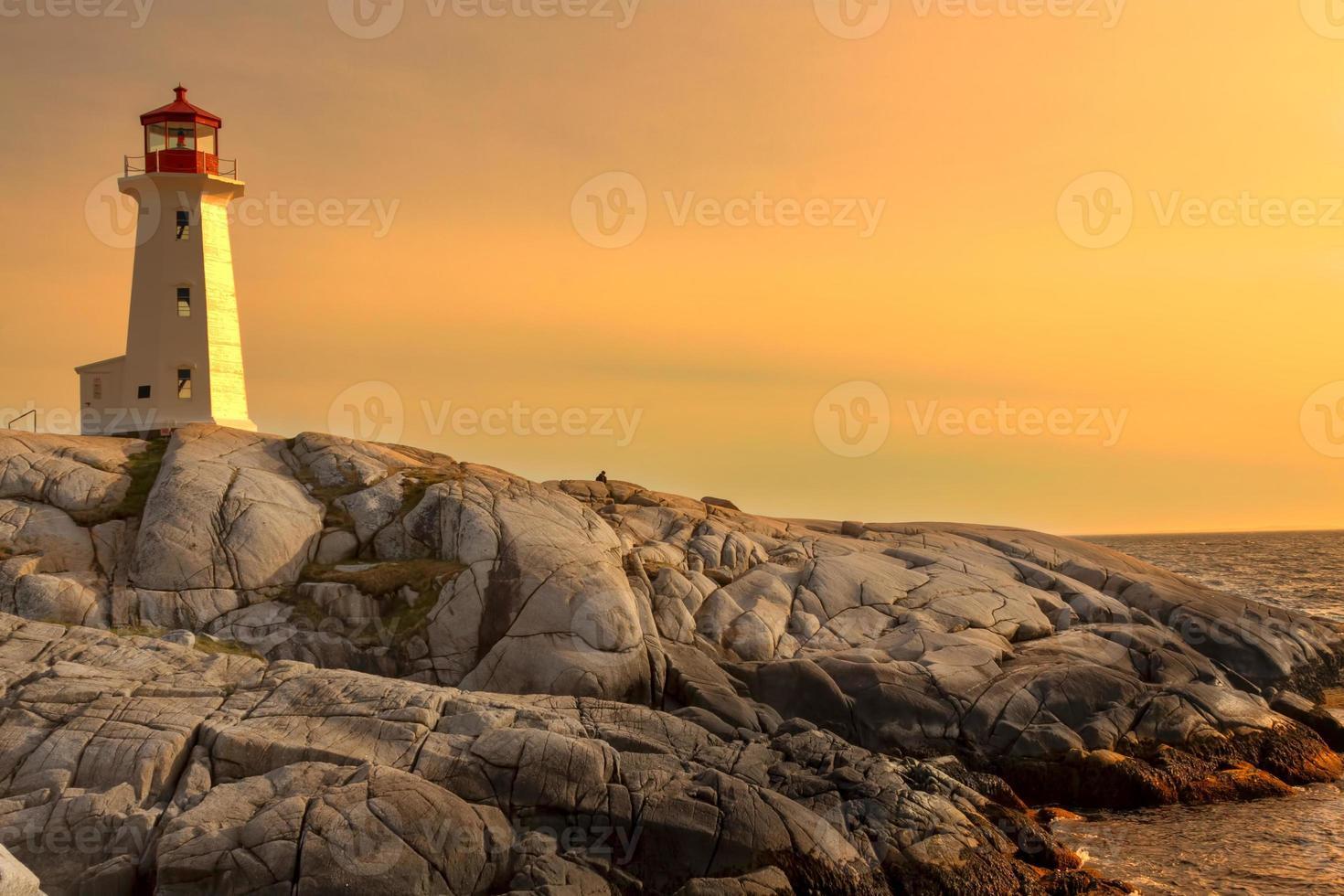 Lighthouse on a rocky shore. photo