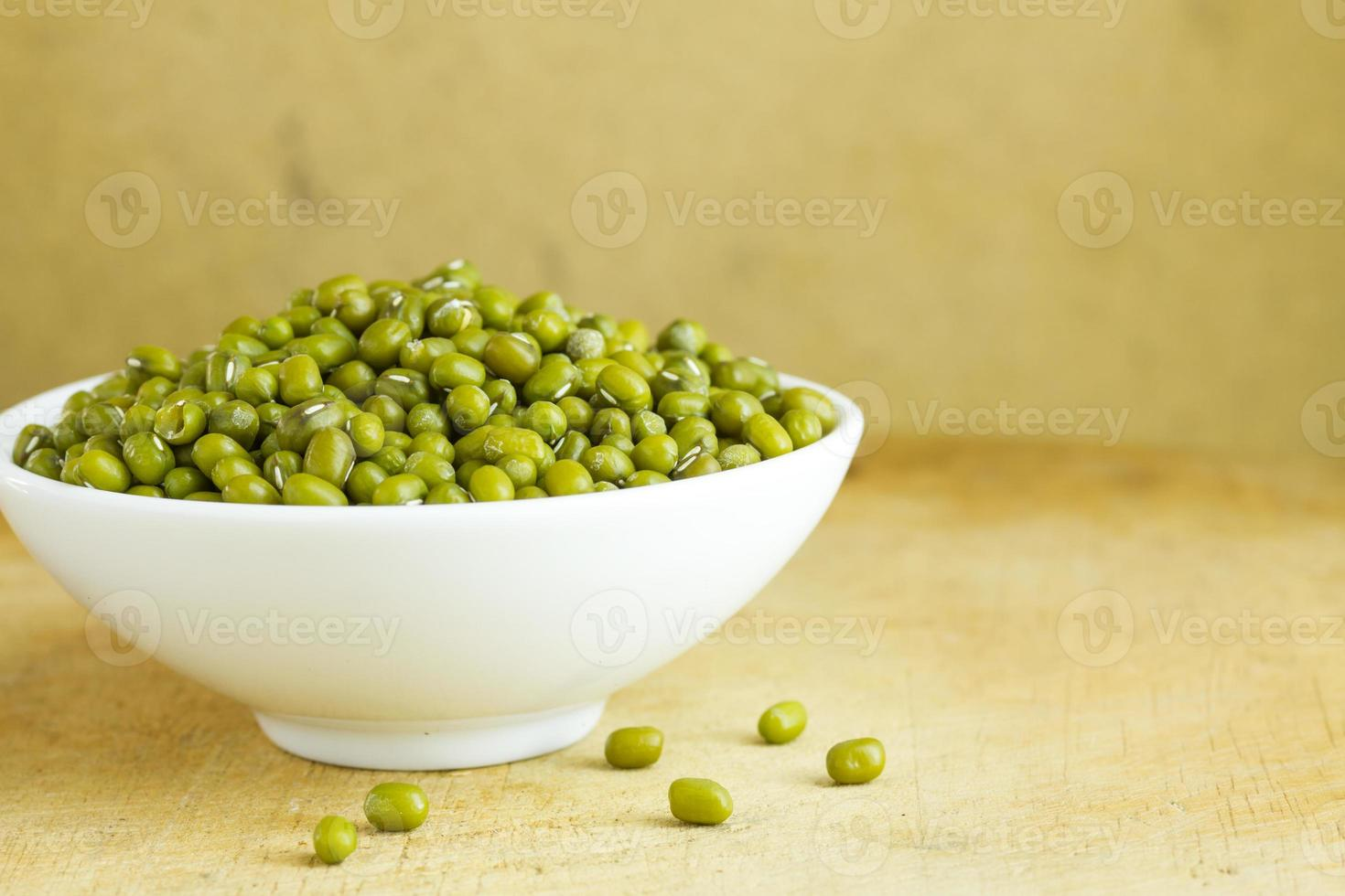Dried mung beans onwarm background photo