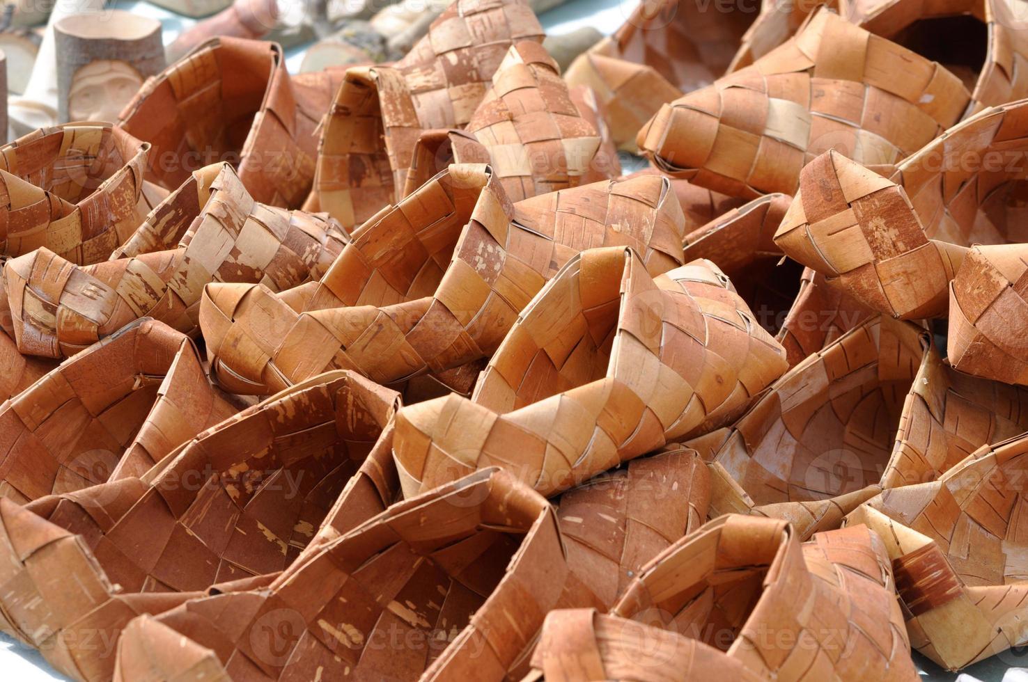 Russian National wicker shoes of birch bark photo