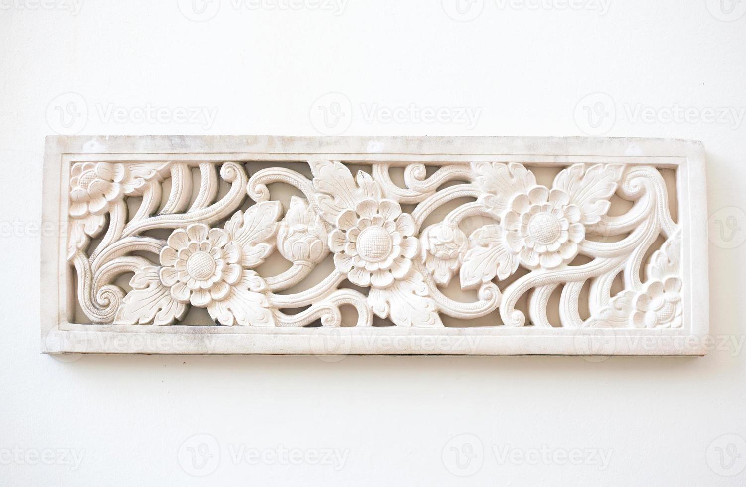 White thai art stucco wall in Thailand photo