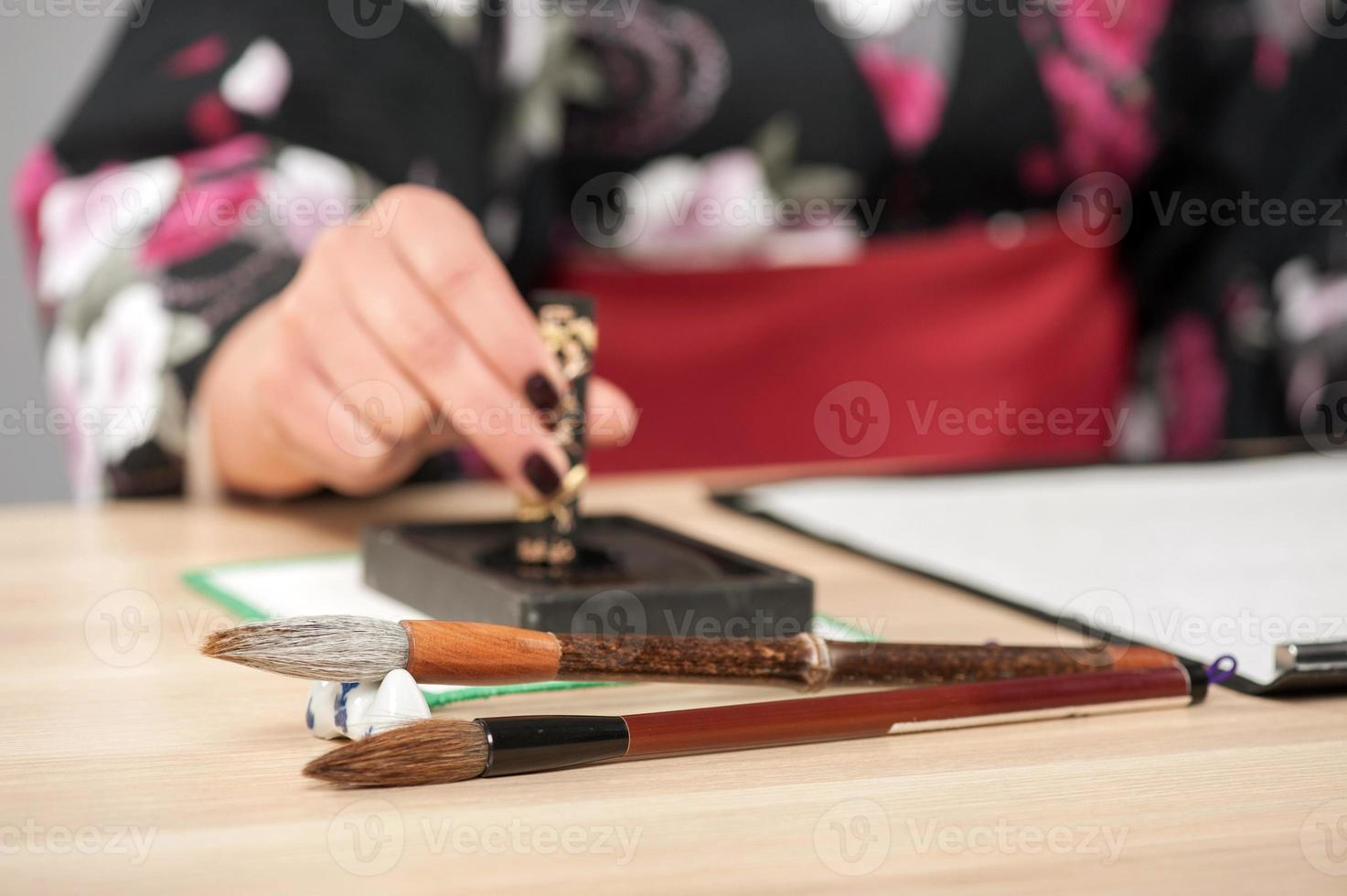 Traditional calligraphy on wooden table photo