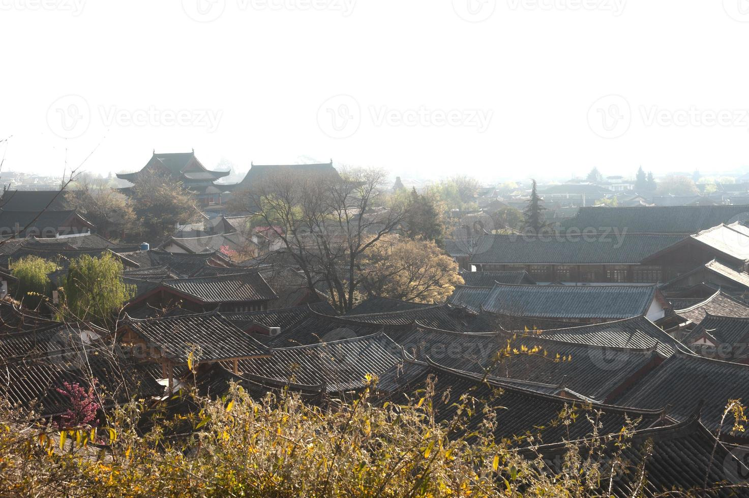 Roofs of ancient historical Lijiang Dayan  old town. photo