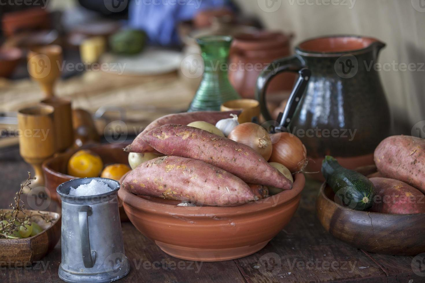 Rustic garden vegetables with old fashioned crockery photo