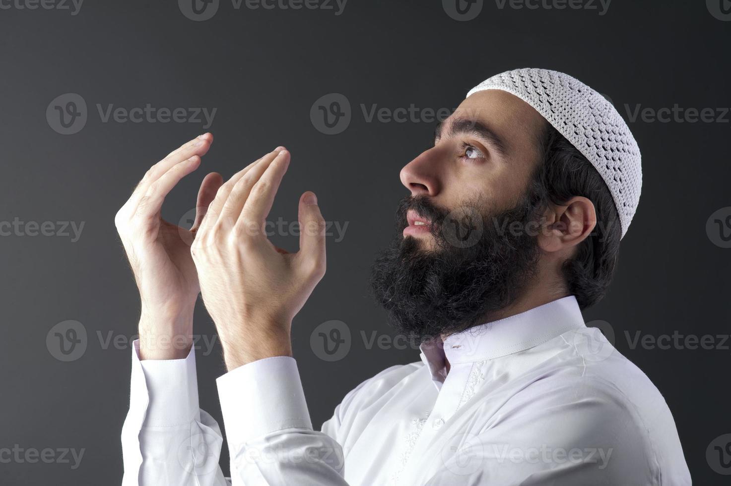 arabian muslim man praying photo