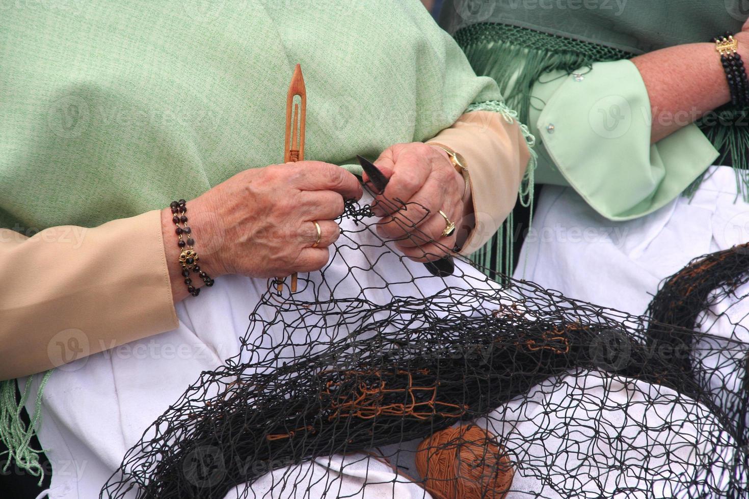 het werk van de vissersvrouw foto