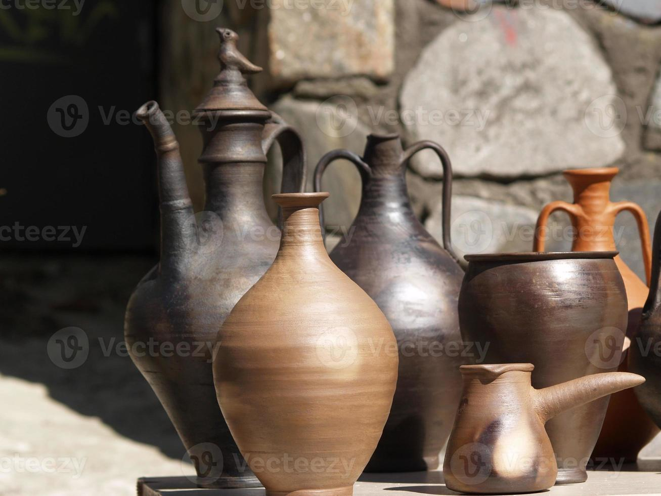 Collection of ancient clay dishes photo