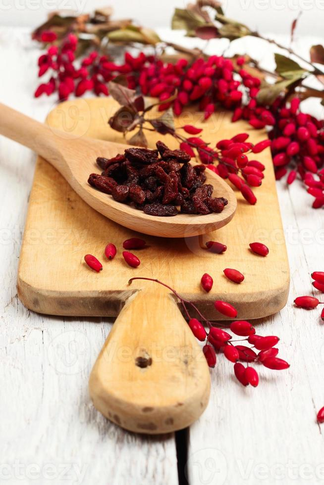 Goji berries in a spoon with barberry photo