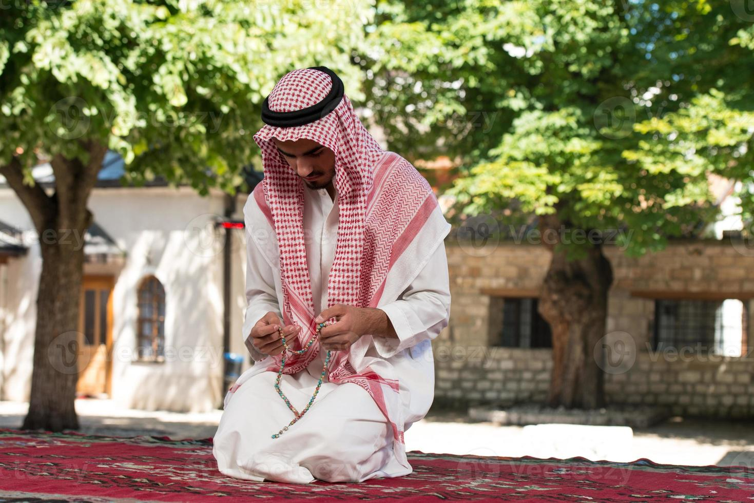 Young Muslim Man Praying photo