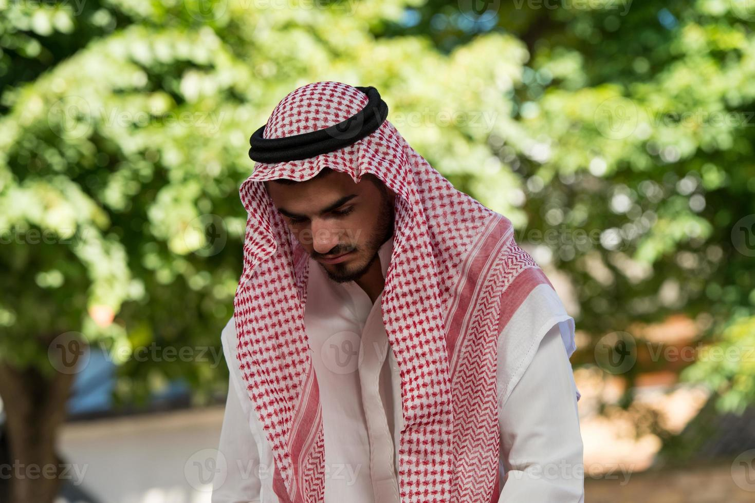 Young Muslim Guy Praying photo