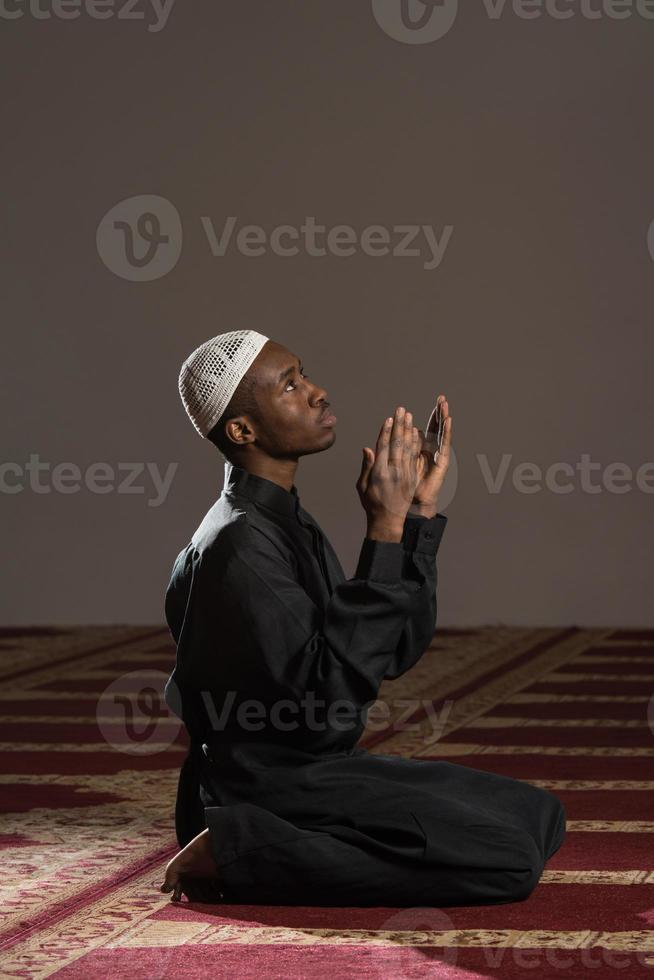 Young African Muslim Guy Praying photo